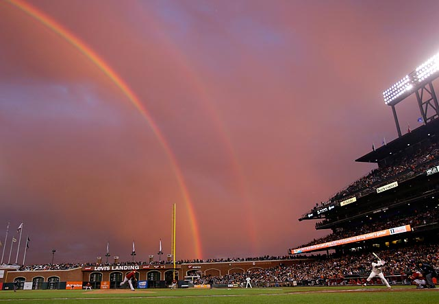 Diamondbacks starter Trevor Cahill throws a pitch to the Giants' Pablo Sandoval as not merely a single, but a double rainbow appears all the way across the San Francisco sky.