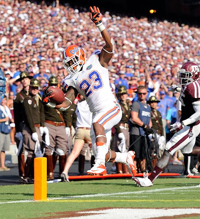 Mike Gillislee scores one of his two touchdowns in Florida's 20-17 victory over Texas A&M in College Station, Texas. It was the Aggies' first SEC game after moving from the Big 12 last season.