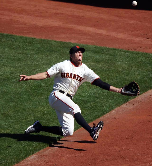 San Francisco Giants outfielder Hunter Pence lets his tongue hang out while sliding to catch a ball in a game against the Los Angeles Dodgers.