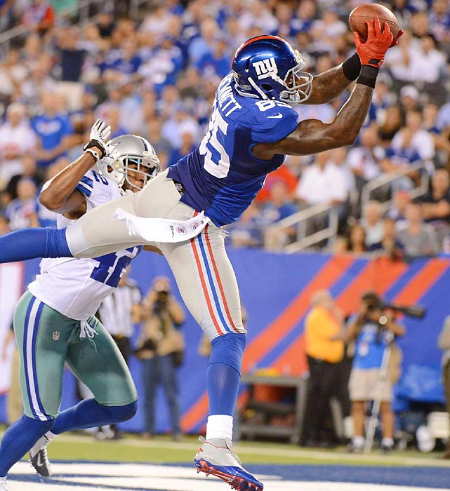 Giants wide receiver Martellus Bennett catches a nine-yard pass from Eli Manning for a touchdown late in the fourth quarter. The touchdown would not be enough, as the Giants dropped their home opener after winning the Super Bowl last season.