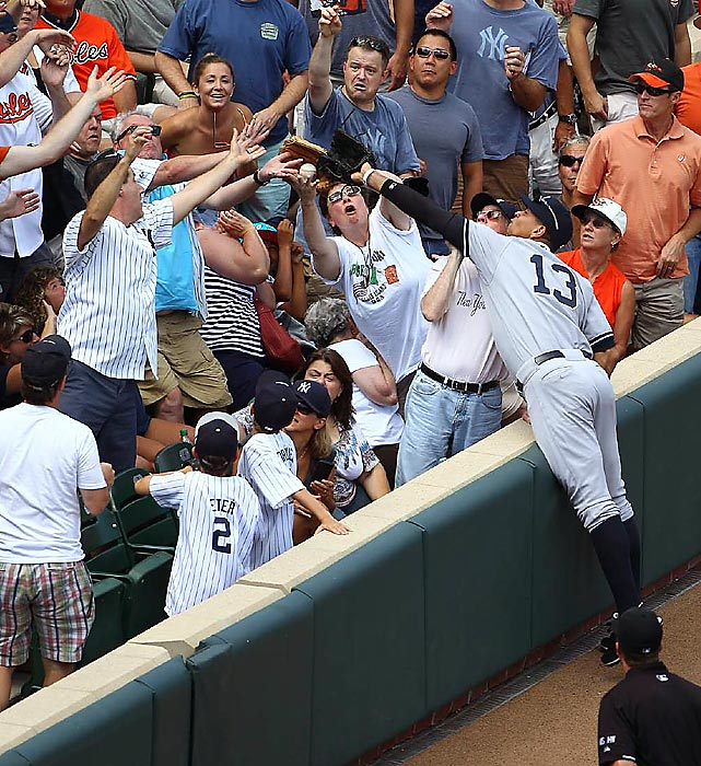 Alex Rodriguez can't quite reach a foul ball among a slew of Yankee fans during a game at Camden Yards in Baltimore.
