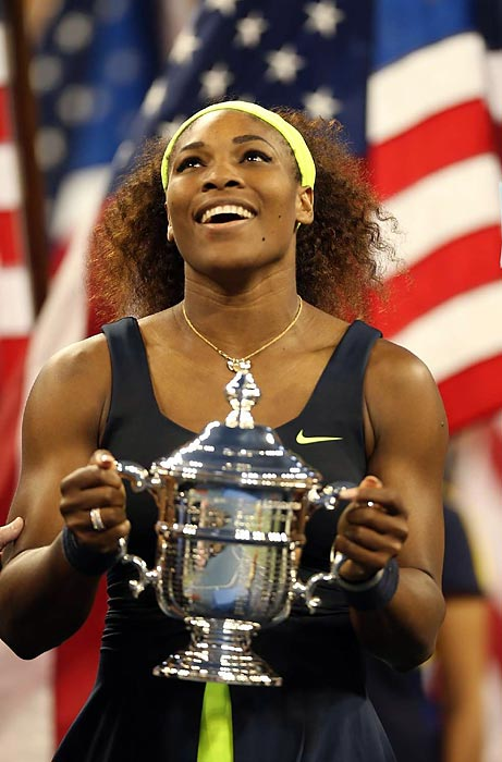 """Serena Williams hoists the U.S Open trophy after defeating Victoria Azarenka in the women's final. It marks Williams' 15th Grand Slam victory and earned her the compliment as """"the greatest ever"""" from Azarenka."""