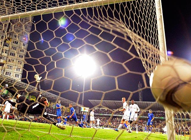 England's James Milner slots a goal past Moldova's Stanislav Namasco during their 2014 World Cup qualifying soccer match at Zimbru stadium in Kishinev, Moldova.