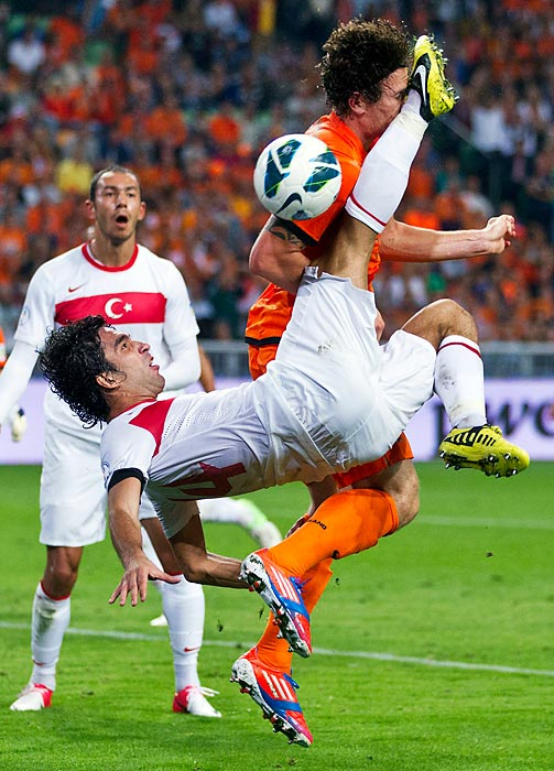 Turkey's Arda Turan kicks Netherlands' Janmaat squarely in the face during a 2014 World Cup qualifier in Amsterdam.