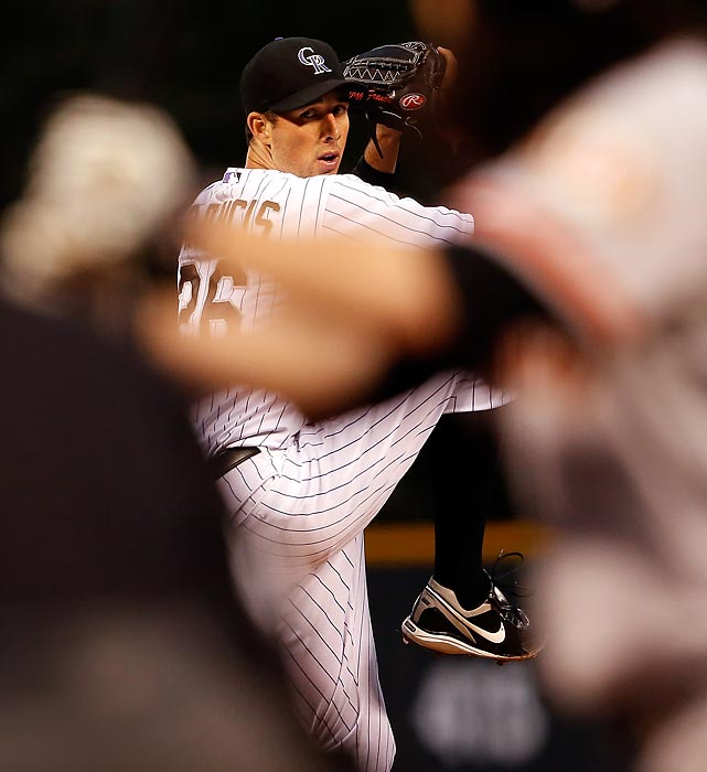 The Rockies' Jeff Francis gets ready to fire a pitch against the San Francisco Giants.