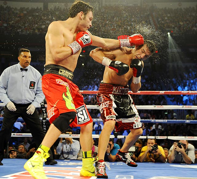 Julio Cesar Chavez Jr. lands a left to the head of Sergio Martinez in the 10th round of their WBC middleweight title fight at the Thomas & Mack Center in Las Vegas.