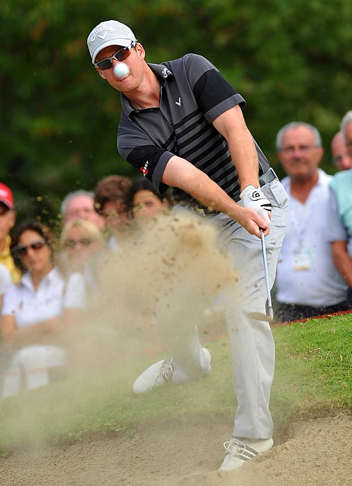 Garth Mulroy of South Africa plays his bunker shot on the 17th hole during the final round of the BMW Italian open at Royal Park Golf & Country Club in Turin, Italy.