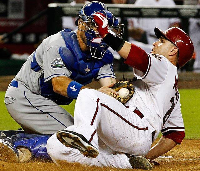 Dodgers catcher A.J. Ellis tags out Diamondbacks' Miguel Montero as he tries to score.