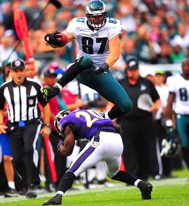 Eagles tight end Brent Celek hurdles Ravens safety Ed Reed, much to the delight of the Eagles' sideline during Philadelphia's 24-23 win over Baltimore.