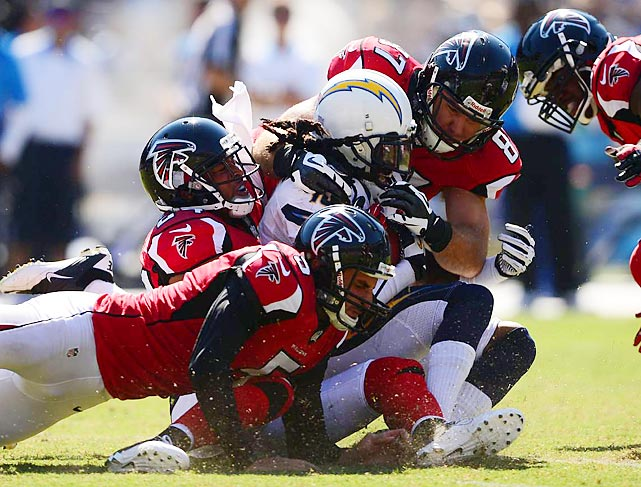 Atlanta punter Matt Bosher attempts to make a tackle during the Falcons' game against the Chargers.