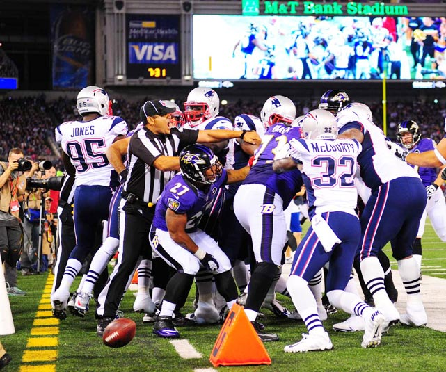 The replacement officials break up one of the many skirmishes between New England and Baltimore during the Ravens' 31-30 win.
