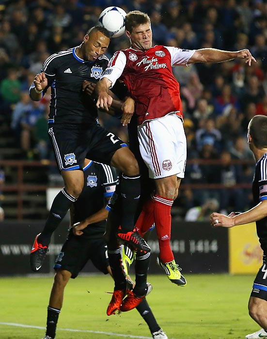 Victor Bernardez (#26) of the San Jose Earthquakes and David Horst (#12) of the Portland Timbers go for the ball at Buck Shaw Stadium in Santa Clara, Calif.