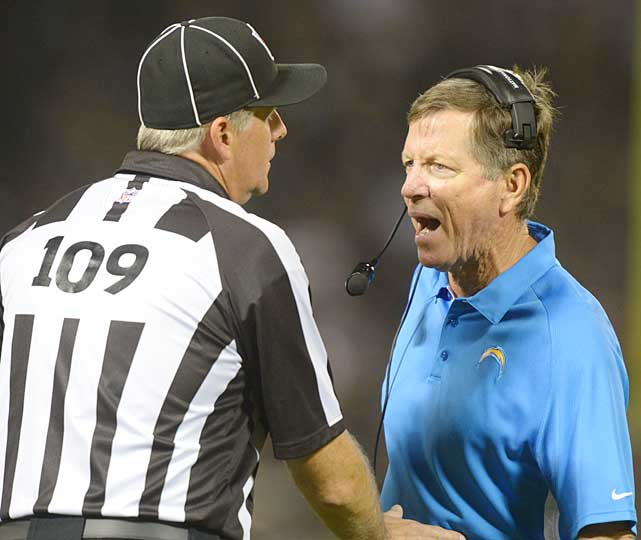 San Diego coach Norv Turner attempts to make a point with head linesman Noal Strickland during San Diego's season opener against Oakland.