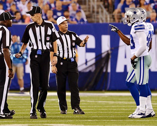 Officials try and mitigate a dispute with two Dallas players in the season opener against the Giants.