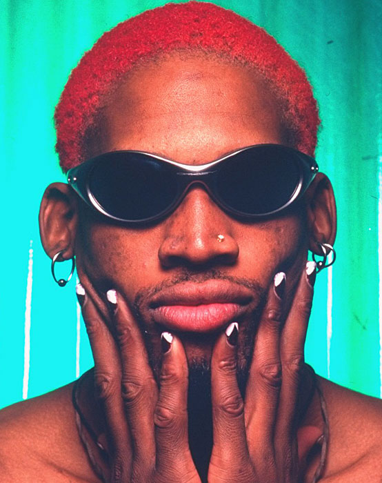 Dennis Rodman makes sure his black and white nails match his bright red hair.