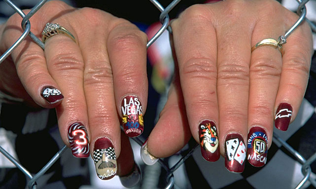 A NASCAR fan shows off her manicure before a 1998 race at Las Vegas Motor Speedway.
