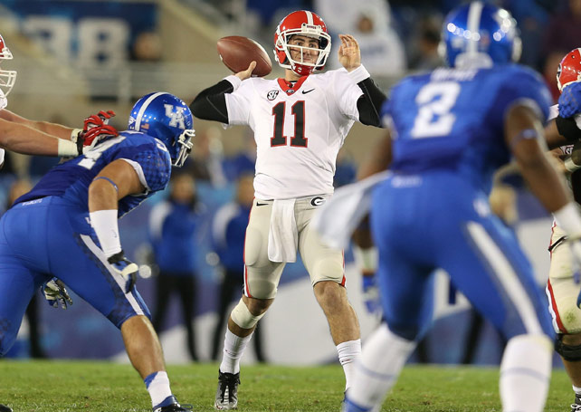 Aaron Murray's record day helped No. 13 Georgia survive a scare. The Bulldogs' QB threw four touchdowns to become the school's all-time career leader and help his team pull off a 29-24 victory over Kentucky. The junior finished 30 of 38 for 427 yards, helping Georgia improve to 6-1 and stay within reach of 7-0 Florida leading up to next week's showdown between the two teams.