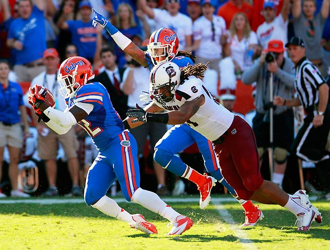 Florida is now in driver's seat to win the SEC East. The Gators dominated South Carolina in Steve Spurrier's return to the Swamp, a game in which the outcome was never in doubt. Jeff Driskel completed 11-of-16 passes for 93 yards and four scores, tight end Jordan Reed hauled in two receiving touchdowns and the Gators shut down the Gamecocks' attack all afternoon. Florida forced four turnovers, including a second-quarter fumble recovery that Chris Johnson (pictured) returned to the one-yard line.
