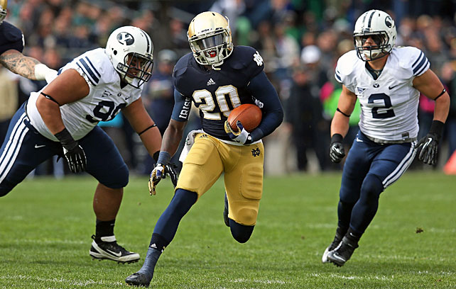 It was closer than expected, but Notre Dame held off BYU to stay unbeaten heading into next week's showdown at Oklahoma. Tommy Rees started for the Irish and threw for 117 yards and a touchdown, while running backs Theo Riddick and Cierre Wood (pictured) rushed for 143 and 114 yards, respectively. The Notre Dame defense surrendered a touchdown for the first time since Sept. 8, but it came up big when it mattered most. Manti Te'o and Co. kept the Cougars off the scoreboard for the entirety of the second half.