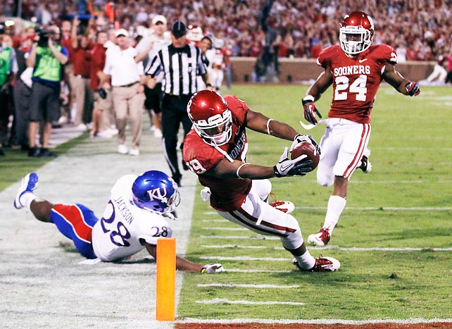 Oklahoma is on quite an offensive roll in advance of next week's game with defensive-minded Notre Dame. The Sooners cruised against the Jayhawks, as Landry Jones completed 20-of-30 passes for 300 yards and three touchdowns. Six Oklahoma receivers, including Justin Brown (pictured), tallied double-digit receiving yardage totals.