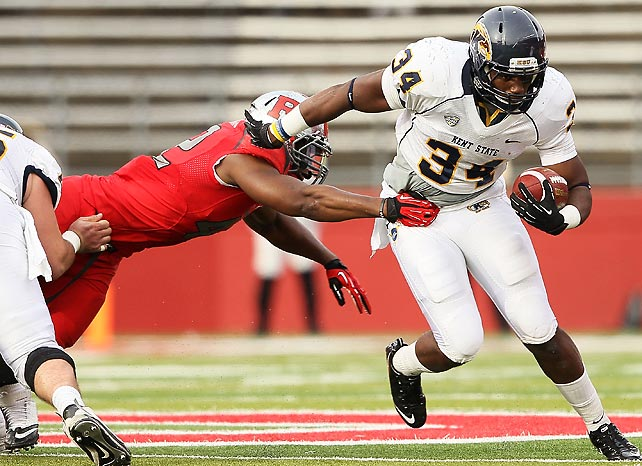 Louisville is now the Big East's lone undefeated team. Rutgers' quest for a perfect season ended in surprising fashion, as Kent State forced five turnovers to beat a ranked team for the first time. Trayion Durham (pictured) rushed 22 times for 131 yards and a score.