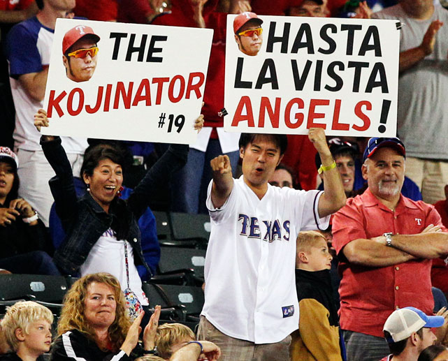 Rangers fans hold signs for relief pitcher Koji Uehara (aka - The Kojinator).