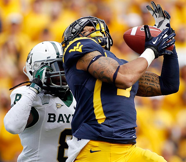 Stedman Bailey of the West Virginia Mountaineers catches a 47-yard touchdown pass in the first half against K.J. Morton of Baylor. That was merely the beginning for Bailey, who would catch 13 passes for 303 yards and five touchdowns in the Mountaineers 70-63 victory.