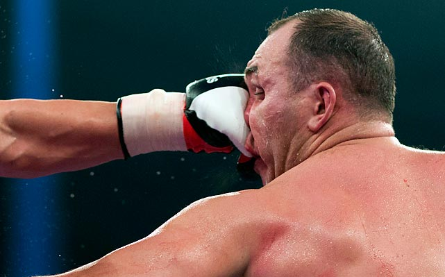 Alexander Ustinov of Belarus absorbs a punch from EBU (European) heavyweight champion Kubrat Pulev of Bulgaria in Hamburg, Germany. Pulev knocked out Ustinov in the 11th round.