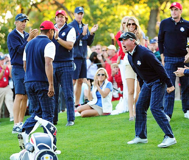 The U.S. team celebrates after Tiger Woods successfully makes a putt. There was little for the Americans to celebrate on Sunday, as they surrendered the largest lead in Ryder Cup history.