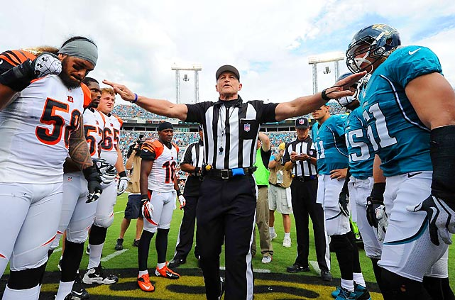 Iconic NFL referee Ed Hochuli announces the coin toss in Sunday's game between Cincinnati and Jacksonville. It was Hochuli's and the normal NFL officials' first game after being locked out for the entire preseason and the first three weeks of the regular season.