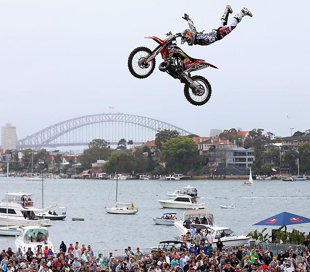 A BMX biker throws a trick to an adoring audience in Sydney, Australia.
