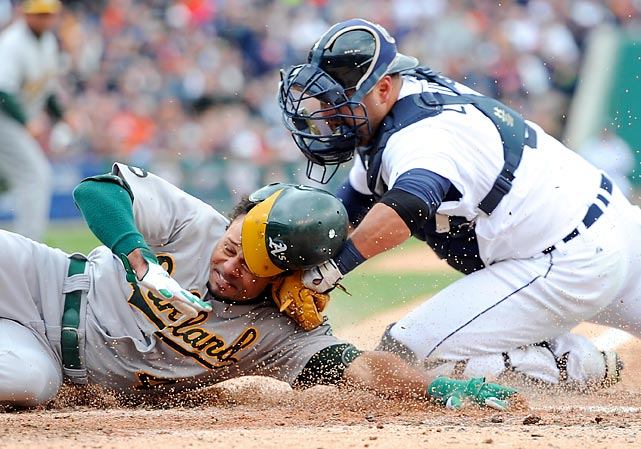 The Athletics' Coco Crisp is tagged out at home by the Tigers' Gerald Laird in the top of the third inning during Game 2 of the American League Division Series.
