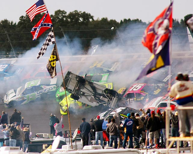 A massive, 25-car wreck on the final turn caused chaos at the finish at Talladega on Sunday, in the fourth race in the Chase for the Sprint Cup championship. Matt Kenseth ran clear of the pileup to take the checkered flag; Brad Keselowski finished seventh to extend his Chase lead to 14 points. Miraculously, no one was seriously injured.