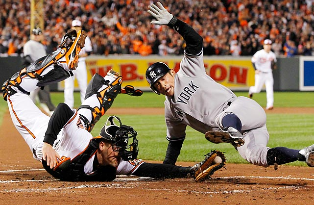 The Yankees' Ichiro Suzuki leaps past Orioles' catcher Matt Wieters to acrobatically score a run during Game 2 of the American League Division Series in Baltimore.