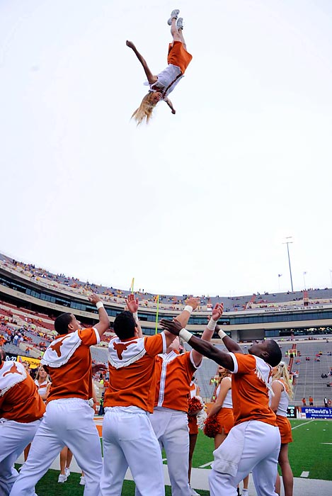 A cheerleader flies really seriously high during the pregame of West Virginia and Texas last Saturday in Austin.