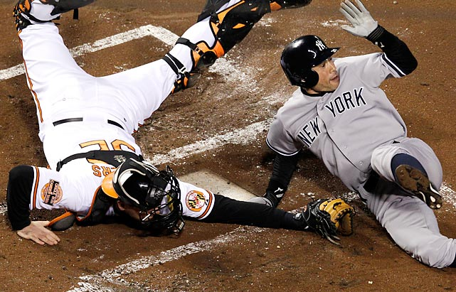 The Yankees Ichiro Suzuki finishes twirling and leaping past Orioles catcher Matt Wieters to score a on a double by Robinson Cano in Game 2 of the ALDS. The Yankees won the series in five games.