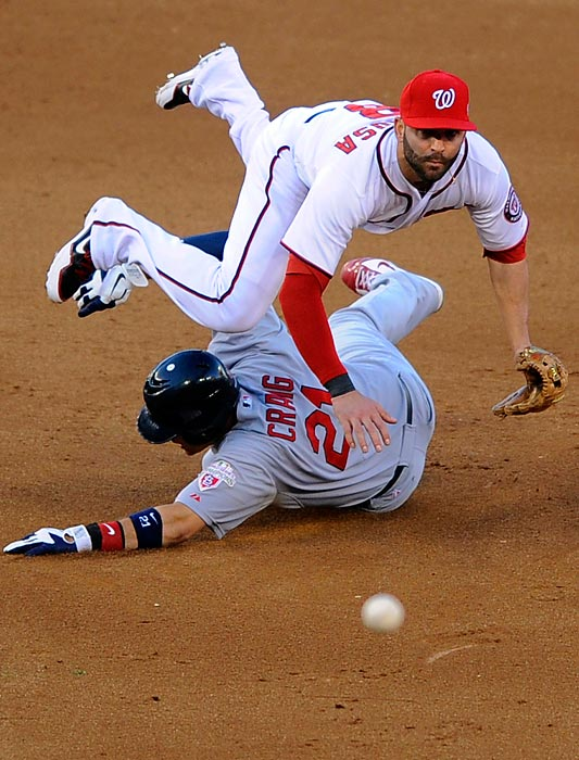 Cardinals first baseman Allen Craig takes out Nationals second baseman Danny Espinosa on an attempted double play ball.