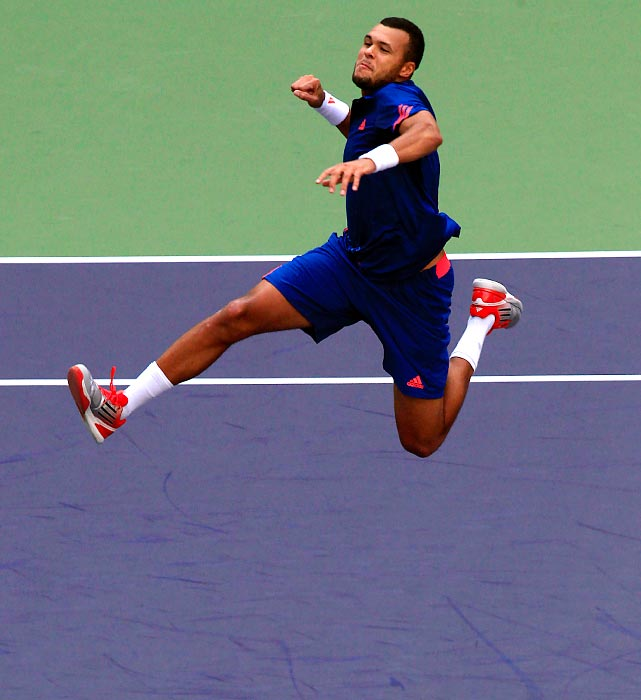 France's Jo-Wilfried Tsonga jumps in celebration after defeating Marcos Baghdatis of Cyprus in their third round match of the Shanghai Masters.