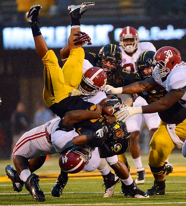 Missouri's Russell Hansbrough is body-slammed by Alabama's LaMichael Fanning during the Tide's blowout win over the Tigers in Columbia, Mo.