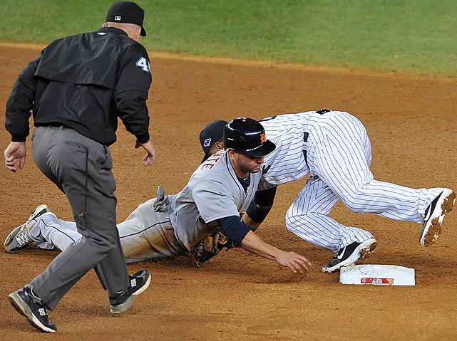 Yankees second baseman Robinson Cano reaches out to tag the Tigers' Omar Infante after Infante overran second base. Though Infante was called safe, replays showed Cano's tag was applied before he reached the bag. The Tigers would score two insurance runs in the inning to secure a 3-0 victory in Game 2 of the ALCS.