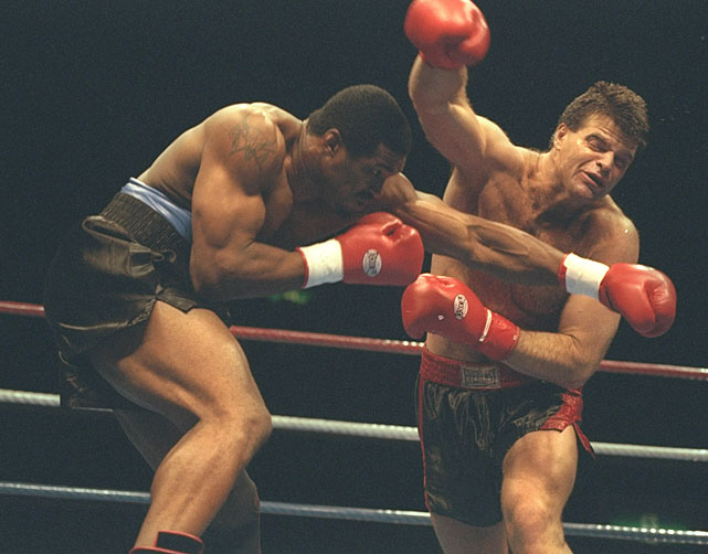 Gastineau and Alonzo Highsmith trade blows during a bout in Tokyo.  Highsmith won the fight with a TKO in the second round.