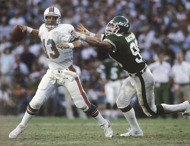 Gastineau pressures Dan Marino during a 1985 Jets-Dolphins game.