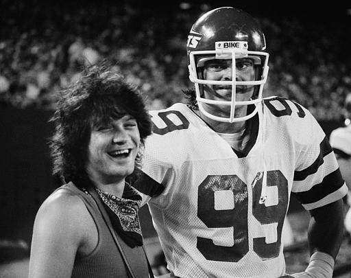 Gastineau invites celebrity friend and Van Halen guitarist Eddie Van Halen to the sideline during a game.