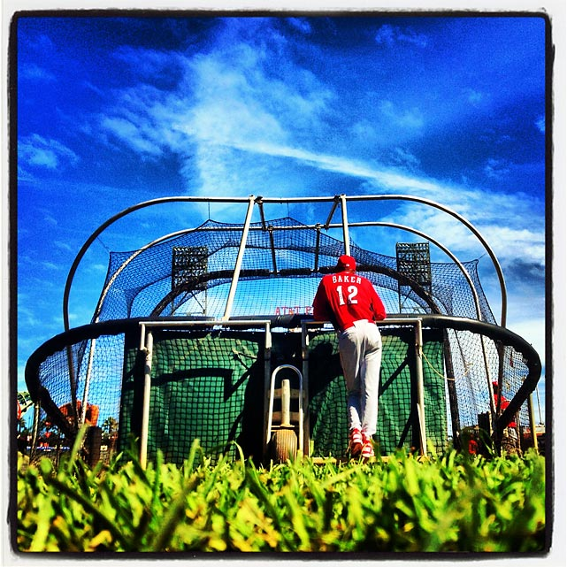 Reds manager Dusty Baker watches batting practice during today's NLDS workout in San Francisco.