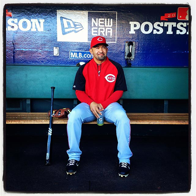 Miguel Cairo of the Reds sits in the dugout before tonight's game against the Giants.
