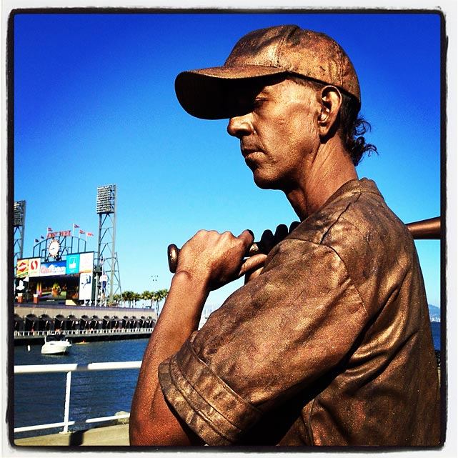 Human statue outside ballpark before tonight's Reds and Giants game.