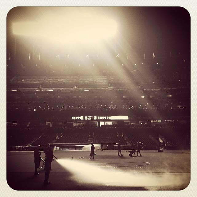 The Giants ground screw waters the infield after game 1 of the NLDS against the Reds.