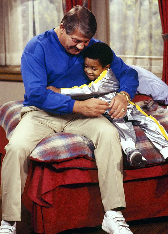 "Alex Karras and Emmanuel Lewis hug during ""The Derby"" episode of Webster, which aired on Oct. 3, 1986."