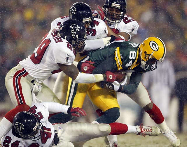 Falcons are the first team to defeat Green Bay in a playoff game at Lambeau Field, winning 27-7.