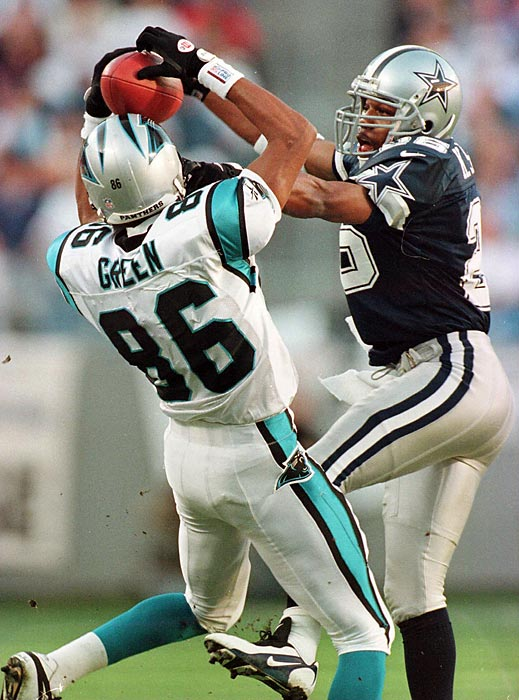 The Panthers shock the defending Super Bowl champion Dallas Cowboys 26-17 after touchdowns by Wesley Walls and Willie Green.